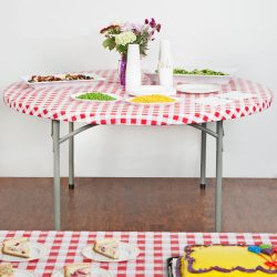 "60"" Round Red Gingham plastic table cover - Kwik Cover - Disposable"